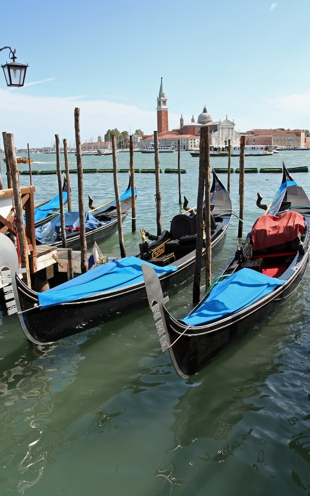 Grand Canal in Venice, Italy. Gondola Boat lined up along the city's port.