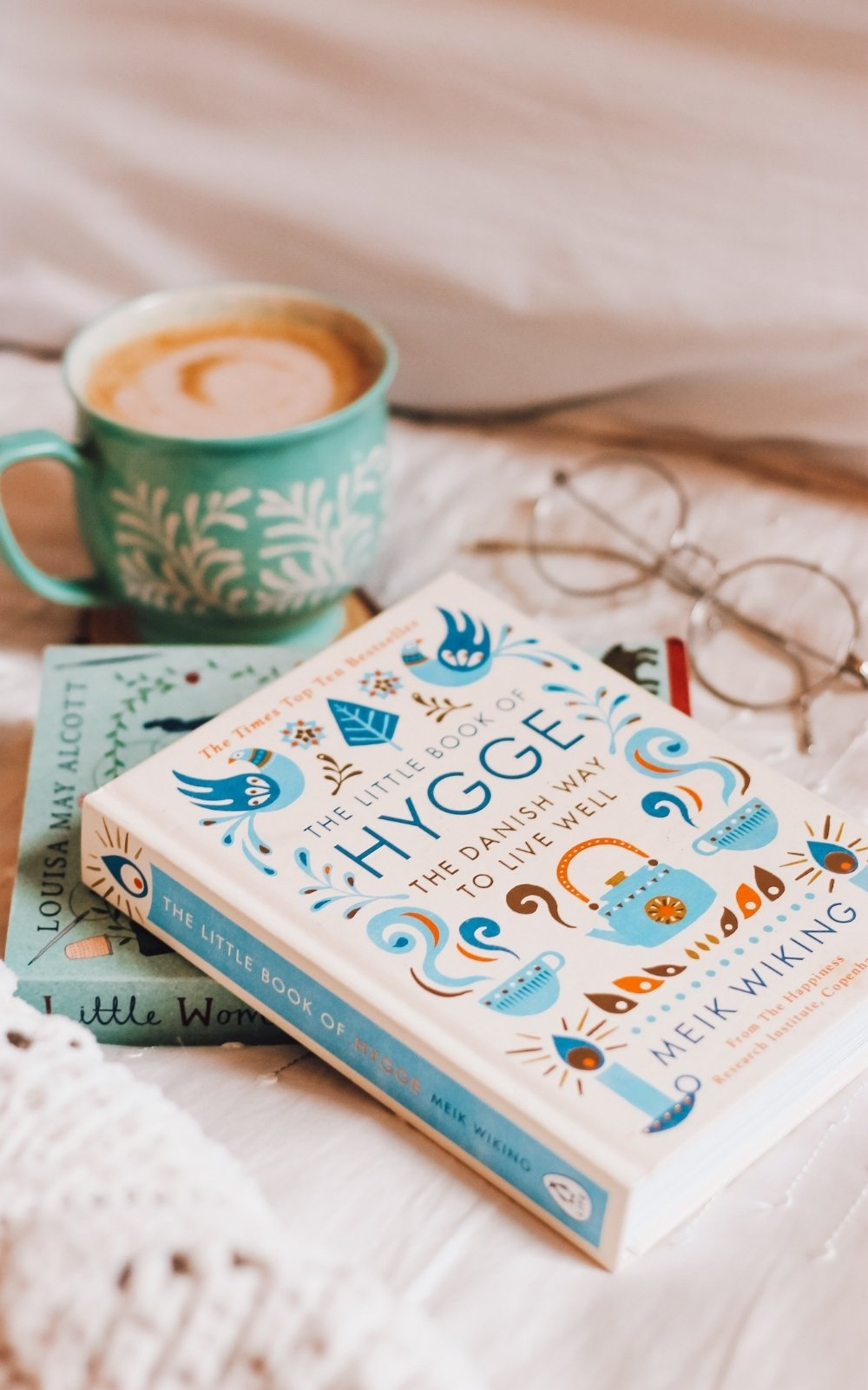 Personal Development Books- Stock Image of Coffee and Book, Hygge by Meik Wiking